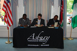 Dr. William Udotong, Dr. Tim Tennent, and Dr. Douglas Carew Signing Documents - 8