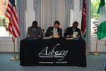 Dr. William Udotong, Dr. Tim Tennent, and Dr. Douglas Carew Signing Documents - 10