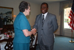 Dr. Cathy Stonehouse Shaking Hands with Dr. William Udotong