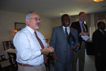 Dr. Jim Miller and Dr. William Udotong at a Global Partnership Signing