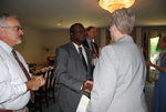 Dr. William Udotong Shaking Hands with Dr. Leslie Andrews