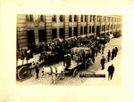 Aerial view of gathering of people near the cart from which George B. Ellis would sing and preach from
