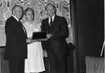 Abbott, J. D. gives 1977 Holiness Exponent of the year award to Bishop Henry Ginder
