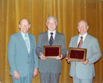 Abbott, J D awarding Holiness Exponent of the Year Award to Richard and Willard Taylor