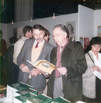 Ed Terpstra and Alfred Vandenheuve reading a book by ESJ on the Day of the Religious Book, Amsterdam