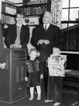 ESJ with the Griev family (Norman (L), Stephen (R) and a little girl), 1953