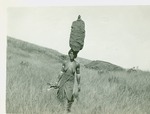 African woman carrying load on head