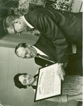 James, Gilbert with Esther being presented travel certificate